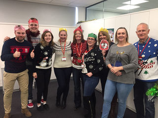 The Marketing & HR Team donning their best Christmas Jumper